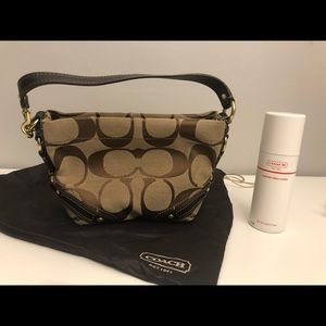 Brown Coach purse with custom purse cleaner